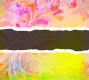 Torn cardboard with colorful swirls Royalty Free Stock Images