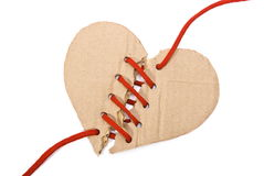 Torn cardboard heart. With red shoelace royalty free stock photos