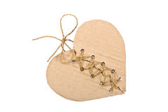 Torn cardboard heart with rope Stock Images