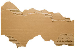 Torn cardboard strip. The roughly ripped and jagged edges of cellulose cardboard form open space for text to be added. The background is white isolated royalty free stock photos