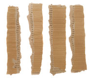 Torn Cardboard Strips. Torn strips of corrugated cardboard isolated on a white background royalty free stock image