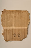 Torn cardboard and symbols Royalty Free Stock Images