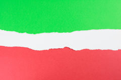 Torn colored paper background. Green, white and red overlapping torn paper Stock Photo