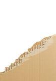Torn corrugated cardboard. Royalty Free Stock Photo