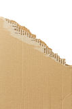 Torn corrugated cardboard. Royalty Free Stock Images
