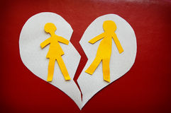 Torn couple. Paper cutout couple on a torn heart - divorce concept stock photos