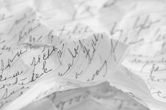 Torn and crumpled handwritten message Stock Images