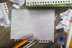 Torn crumpled notebook sheet Stock Photography
