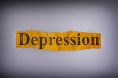 Torn crumpled piece of yellow paper with the word Depression Stock Photography