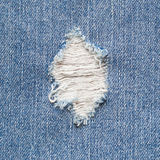 Torn denim Stock Images