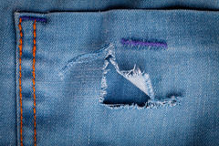 Torn denim background Stock Photography