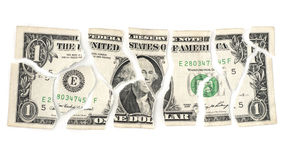 Torn Dollar. Isolated torn devalued dollar on a white background royalty free stock images