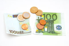 Torn Euro banknote and coins Stock Photo