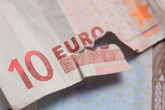 Torn euro note Stock Images