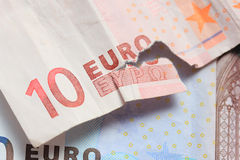 Torn euro note and vintage greek coin Royalty Free Stock Image