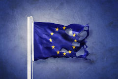 Torn European Union flag against grunge background.  Stock Images