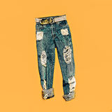 Torn fashion blue jeans Royalty Free Stock Image