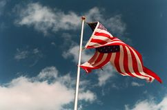 Torn Flag. A torn American flag waves in the breeze royalty free stock photography