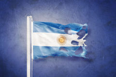 Torn flag of Argentina flying against grunge background Royalty Free Stock Photography