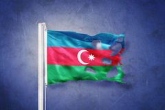 Torn flag of Azerbaijan flying against grunge background Royalty Free Stock Photo