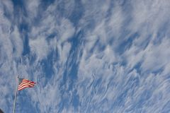 Torn Flag with clouds