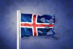 Torn flag of Iceland flying against grunge background.  Stock Images