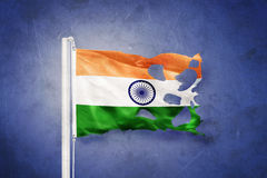 Torn flag of India flying against grunge background Stock Images