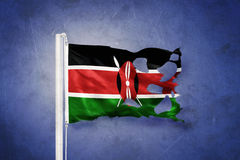 Torn flag of Kenya flying against grunge background Royalty Free Stock Photos