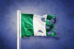 Torn flag of Nigeria flying against grunge background vector illustration