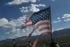 Torn Flag. Over-flown flag of a Veteran in Cottonwood Arizona Stock Photography