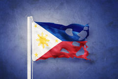 Torn flag of Philippines flying against grunge background Stock Photography