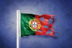 Torn flag of Portugal flying against grunge background Stock Photography