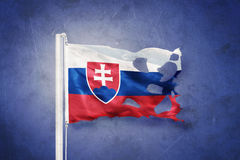 Torn flag of Slovakia flying against grunge background Stock Photo