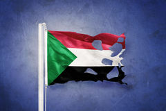 Torn flag of Sudan flying against grunge background Royalty Free Stock Image