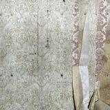 Torn floral wallpaper Stock Photos