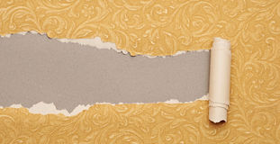 Torn gold paper Royalty Free Stock Photos