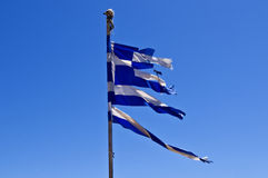 Torn Greek Flag Against Blue Sky Royalty Free Stock Images