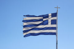 Torn Greek flag on blue background Stock Images