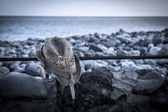 Torn hat on the beach. In Gomera Island Royalty Free Stock Photography