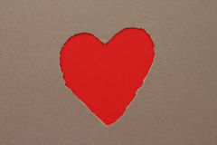 Torn heart in paper. Torn red heart in paper with copy space stock photo
