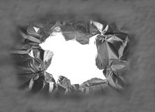 Torn hole. Hole torn in a piece of metal, closeup royalty free stock photo