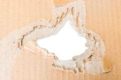 Torn hole in cardboard paper Stock Image