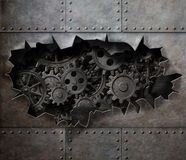 Torn hole in old metal with rusty gears and cogs. Old metal armour background with rusty gears and cogs Royalty Free Stock Photography