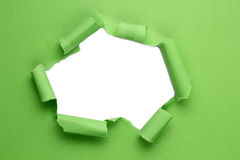 Torn hole paper. On white background royalty free stock photography