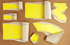 Torn holes. Set of torn paper holes with yellow background Royalty Free Stock Photos
