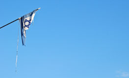 Torn Israel flag. A lone Israel flag that is torn royalty free stock image