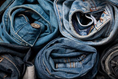 Torn jeans roll stack background blue denim fashion beauty. Denim jeans texture design fashion Royalty Free Stock Image