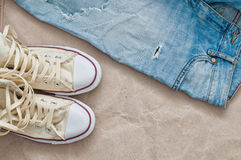 Torn jeans and shoes Royalty Free Stock Image