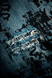 Torn jeans texture. Old torn blue jeans background royalty free stock photo