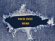 Torn jeans texture with space for text stock image